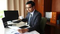 Businessman doing analysis planning business project in office.
