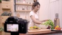Female use organic vegetables preparing salad for fit body at home.