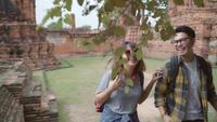 Traveler Asian couple spending holiday trip at Ayutthaya, Thailand.