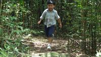 Boy running and playing in forest