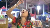 Children Little Girl Enjoys Eating At Street Food.