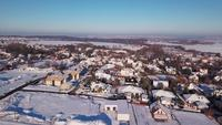 Drone flying over a snowy village in 4K