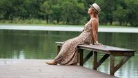 Beautiful woman relaxing near the lake