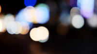 Blurred bokeh of night city traffic lights.