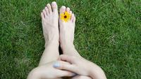 Feet of a woman on the grass