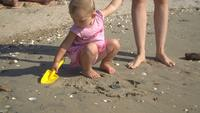 A Child Plays on the Beach