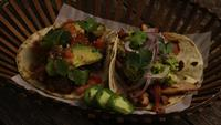 Rotating shot of delicious tacos on a wooden surface - BBQ 151