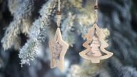 Wooden Christmas Toys Hanging On The Branches Of A Christmas Tree