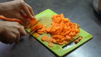 Cutting Carrots On The Board