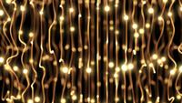 Brillantes cuerdas enredadas doradas con luces en movimiento loop