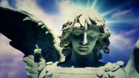 The Statue of an Angel on Time Lapse Blue Clouds