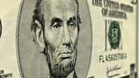 Presidents George Washington and Abraham Lincoln on One and Five Dollar Bills