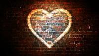 Bucle de fondo de símbolo de corazón brillante