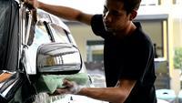 Carwash Staff Cleaning A Car