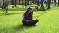 Young Woman Reading In The Park
