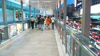People Walking On The Skywalk In Bangkok