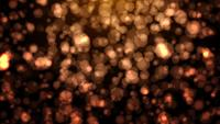 Partículas de polvo de oro flotante con Bokeh