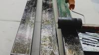 Painting Roller On The Steel Rod
