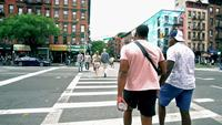African American men walk across street in New York City