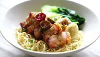 Egg noodle with crispy pork belly and wonton