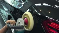 Polishing wax on car