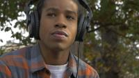Young Man Listening to Music in Headphones