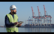 Port Worker Working With A Tablet