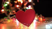 Red Fabric Heart with Twinkle Lights Behind it