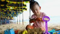 Asian Baby Girl Playing with Beach Toys