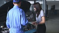 Auto Technician Showing Car Engine to Costumer