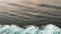 Smooth waves from the side of a boat