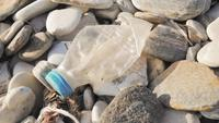 A Plastic Bottle on a Rocky Beach
