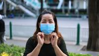 Asian Woman Wearing Protective Mask