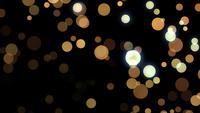 Gold glitter particles bokeh