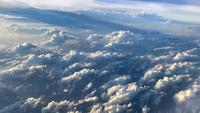 Fly in the Sky with Clouds and Beautiful Light, Airplane View.
