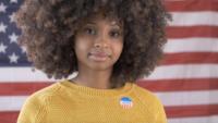 afroamerikansk kvinna väljer