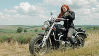 The Red-Haired Biker Girl Parking her Motorcycle.