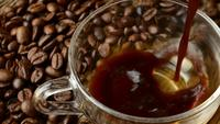 Pouring Black Coffee in a Cup