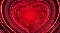 Hermosos corazones rojos brillantes moviéndose hacia afuera