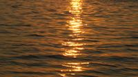 Yellow Aegean Sea With The Sparkling And Sunbeams Surface