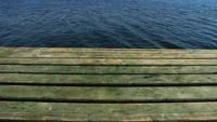 Green Wooden Pier And Calm Sea