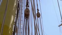 Details of ropes and reels in a historic galleon in slow motion