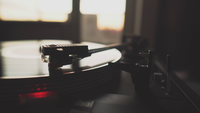 A record player spinning in early morning setting