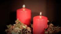 Deux bougies rouges en boucle