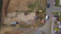 Top view of excavator working on a field in 4K