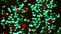 Blurred green hearts shaped lights
