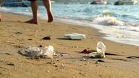 Plastic rubber and waste are left on beach