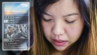 Femme asiatique heureuse souriant avec réseau social smartphone