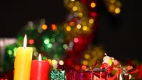 Gift Boxes and Candle Light in Romantic Bokeh Background
