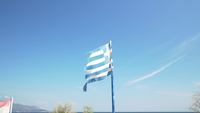 A greek flag blowing in the wind